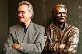 Gunnar with Varg Veum statue